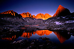 The jagged granite mountains above Dusy Basin catch the last light of a summer's evening. At 11,000 feet, this California basin contains many alpine lakes providing a photographer with endless compositional possibilities.
