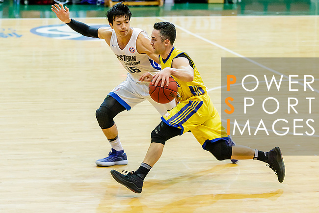 Kepkey Tyler Alexander #55 of Winling Basketball Club dribbles the ball up court against the Xu Adam #16 of Eastern Long Lions during the Hong Kong Basketball League game between Eastern Long Lions and Winling at Southorn Stadium on June 01, 2018 in Hong Kong. Photo by Yu Chun Christopher Wong / Power Sport Images