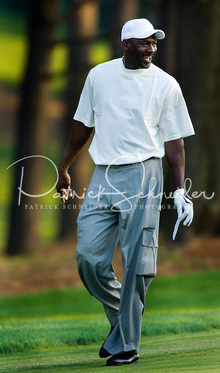 NBA legend Michael Jordan laughs as he plays a round of golf with Tiger Woods during the 2007 Wachovia Championships at Quail Hollow Country Club in Charlotte, NC.