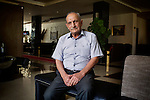 """29/08/15. Shaqlawa, Iraq. -- Nouri, a 70 y.o. retired army officer, now lives at the four star hotel Basma Alsafeer, in Shaqlawa city centre. At the hotel he shares two rooms with his sons' families: one suit for 1million IQD and a room for 700.000 IQD. His sons are all goldsmiths, but they could not find a job suitable for them, and have therefore been without a job for the past 18 months. <br /> <br /> """"Here we don't miss anything, but I feel like a tourist: I hope to go back home soon, I wouldn't have left if my family did not beg me to""""."""