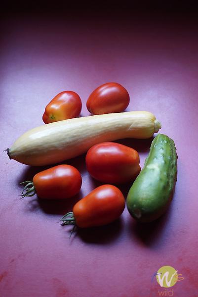 Summer medley. Roma tomatoes, yellow squash; cucumber stillife.