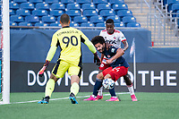 FOXBOROUGH, MA - JUNE 26: Ryan Spaulding #34 of the New England Revolution holds off Bernard Kamungo #7 of North Texas SC near the New England goal during a game between North Texas SC and New England Revolution II at Gillette Stadium on June 26, 2021 in Foxborough, Massachusetts.