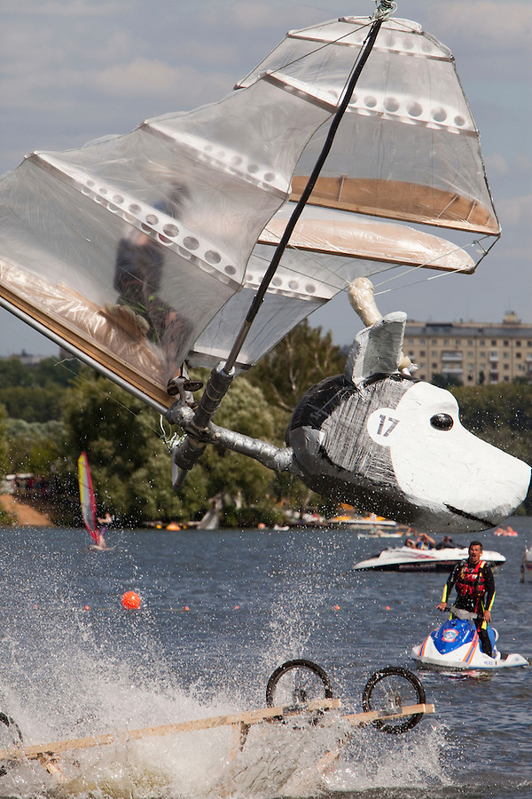 Moscow Russia, 07/08/2011..A contestant and his aircraft crash into the river at at Red Bull Flugtag, when some 100,000 people gathered to watch a variety of homemade makeshift aircraft launched over and into the Moscow river.