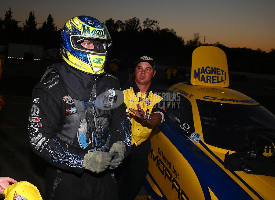 Nov 10, 2013; Pomona, CA, USA; NHRA funny car driver Matt Hagan celebrates after winning the Auto Club Finals at Auto Club Raceway at Pomona. Mandatory Credit: Mark J. Rebilas-