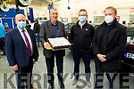 John Hoare with his retirement cake from the staff of the Kerry College Monavalley Campus on Thursday. L to r: Christy Enright, John Hoare, Ioseph Nestor and Con O'Sullivan