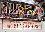 """Several homes in Sampaloc echoed the Philippines' national tourism slogan for 2012, """"It's more fun in ....""""  (Sampaloc, Quezon Province, the Philippines)"""