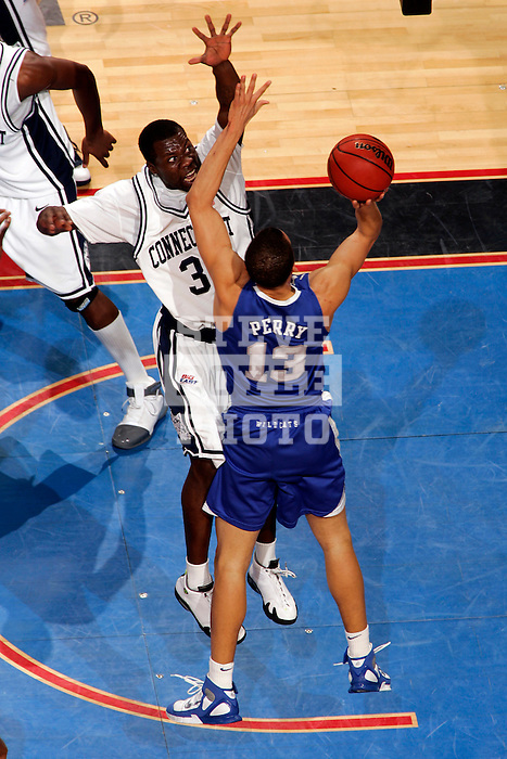 Kentucky forward Bobby Perry (13) shoots over Connecticut forward Denham Brown (33).  Connecticut defeated Kentucky 87-83 in the second round of the NCAA Tournament  at the Wachovia Center in Philadelphia, Pennsylvania on March 19, 2006.