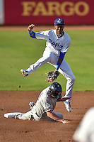 Errol Robinson (9) of the Ogden Raptors attempts to apply a tag to Vince Fernandez (8) of the Grand Junction Rockies as he slides into second base  in Pioneer League action at Lindquist Field on August 24, 2016 in Ogden, Utah. The Raptors defeated the Rockies 11-10. (Stephen Smith/Four Seam Images)