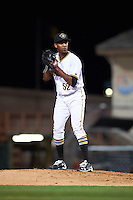Bradenton Marauders relief pitcher Junior Lopez (52) gets ready to deliver a pitch during a game against the Fort Myers Miracle on April 9, 2016 at McKechnie Field in Bradenton, Florida.  Fort Myers defeated Bradenton 5-1.  (Mike Janes/Four Seam Images)