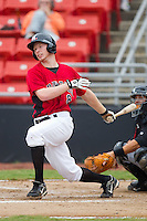 Jared Prince #8 of the Hickory Crawdads follows through on his swing against the Kannapolis Intimidators at  L.P. Frans Stadium August 1, 2010, in Hickory, North Carolina.  Photo by Brian Westerholt / Four Seam Images