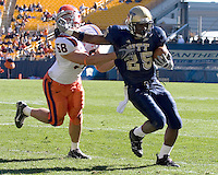 Pitt running back LeSean McCoy (25) stiff arms Syracuse linebacker Mike Stenclik (58).  The Pitt Panthers defeated the Syracuse Orange  20-17 on November 03, 2007 at Heinz Field, Pittsburgh, Pennsylvania.
