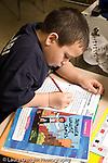 Education Elementary school Grade 2 English language arts test  students at work at desks vertical