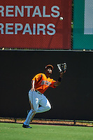 Bowie Baysox outfielder Quincy Latimore (22) catches a fly ball during a game against the Reading Fightin Phils on July 22, 2015 at Prince George's Stadium in Bowie, Maryland.  Bowie defeated Reading 6-4.  (Mike Janes/Four Seam Images)