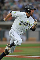 Left fielder Kevin Kaczmarski (10) of the Columbia Fireflies runs out the team's first RBI in the home opener against the Greenville Drive on Thursday, April 14, 2016, the team's first day at the new Spirit Communications Park in Columbia, South Carolina. The Mets affiliate moved to Columbia this year from Savannah. Columbia won, 4-1. (Tom Priddy/Four Seam Images)