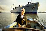 River Thames Waterman Michael Fletcher, docks, pilot guides a Roll on Roll off Ferry from Zeeburger into  Purfleet Thames Terminal,   Essex. Dartford Bridge background 1991 1990s