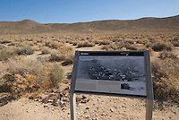 Interpretive sign at Skidoo, a gold-mining boomtown in the Panamint Range on the west side of Death Valley. At its peak in 1907 the town had 700 residents. Death Valley National Park, California.
