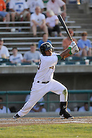 Shortstop Elmer Reyes (13) of the Lynchburg Hillcats bats in a game against the Wilmington Blue Rocks on Tuesday, June 25, 2013, at Calvin Falwell Field in Lynchburg, Virginia. Lynchburg won, 3-2. (Tom Priddy/Four Seam Images)