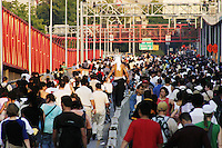 Thousands walk across the Williamsburg Bridge to get home during the blackout in New York City on August 14, 2003.  Although some parts of New York City regained power by 5 AM the next morning, full power was not restored until August 16.