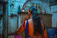 India, Maharashtra, Mumbai, Bombay.  The red light district Falkland Road. Prostitute getting ready to work for the evening.