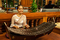Cambodia.  Seam Reap.  Woman Playing a Roneat, the Khmer Xylophone.