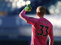 9th January 2021; Goodison Park, Liverpool, Merseyside, England; English FA Cup Football, Everton versus Rotherham United; Robin Olsen of Everton shields his eyes from the low sun