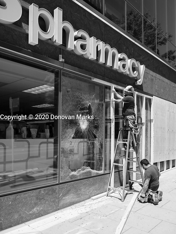 Washington, DC June 1, 2020 - Local restaurants and businesses repair store fronts and install boards in anticipation of more arson and looting.