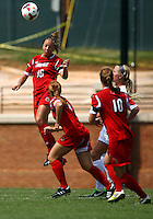 WINSTON-SALEM, NORTH CAROLINA - September 01, 2013:<br /> Erin Yenney (16) of Louisville University heads the ball clear against Wake Forest University during a match at the Wake Forest Invitational tournament at Wake Forest University on September 01. The match was abandoned early in the second half due to severe weather with Wake leading 1-0.