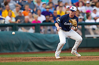 North Carolina third baseman Colin Moran (18) tracks a ground ball during Game 10 of the 2013 Men's College World Series against the North Carolina State Wolfpack on June 20, 2013 at TD Ameritrade Park in Omaha, Nebraska. The Tar Heels defeated the Wolfpack 7-0, eliminating North Carolina State from the tournament. (Andrew Woolley/Four Seam Images)
