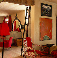 This South African living room is enlivened with bright accents of red in various patterns and textures