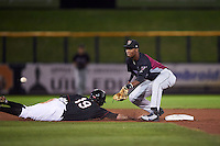 Wisconsin Timber Rattlers shortstop Luis Aviles (3) waits for a throw as Drew Ferguson (19) dives back to second during the second game of a doubleheader against the Quad Cities River Bandits on August 19, 2015 at Modern Woodmen Park in Davenport, Iowa.  Quad Cities defeated Wisconsin 8-1.  (Mike Janes/Four Seam Images)
