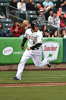 Taylor Lindsey (8) of the Salt Lake Bees hustles towards home plate against the Sacramento River Cats at Smith's Ballpark on April 3, 2014 in Salt Lake City, Utah.  (Stephen Smith/Four Seam Images)
