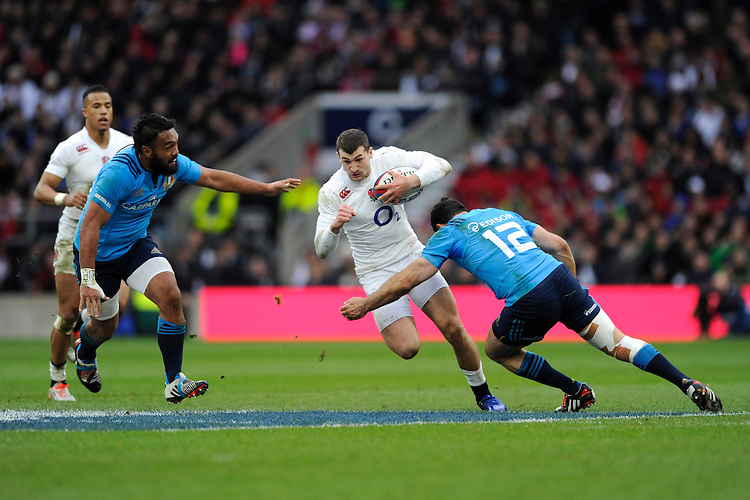 Jonny May of England looks for a gap between Andrea Masi (right) and Kelly Haimona of Italy during the RBS 6 Nations match between England and Italy at Twickenham Stadium on Saturday 14th February 2015 (Photo by Rob Munro)