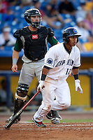 Lake County Captains Francisco Lindor #12 bats in front of catcher Austin Hedges #24 during a game against the Fort Wayne TinCaps at Classic Park on July 2, 2012 in Eastlake, Ohio.  Fort Wayne defeated Lake County 5-4.  (Mike Janes/Four Seam Images)