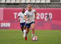 KASHIMA, JAPAN - AUGUST 2: Lindsey Horan #9 of the United States with the ball during a game between Canada and USWNT at Kashima Soccer Stadium on August 2, 2021 in Kashima, Japan.