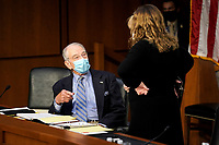 United States Senator Chuck Grassley (Republican of Iowa) speaks to an aide before a US Senate Judiciary Committee business meeting prior to the fourth day for the confirmation hearing of President Donald Trump's Supreme Court nominee Judge Amy Coney Barrett on Thursday, October 15, 2020.<br /> Credit: Greg Nash / Pool via CNP /MediaPunch