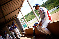 25 June 2011: Paul Mildren of Team France. Illustration of a photographic essay called Life in the dugout, during Czech Republic 11-1 win over France, at the 2011 Prague Baseball Week, in Prague, Czech Republic.