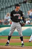 Zach Lee (18) of the Albuquerque Isotopes in action against the Salt Lake Bees at Smith's Ballpark on April 21, 2014 in Salt Lake City, Utah.  (Stephen Smith/Four Seam Images)