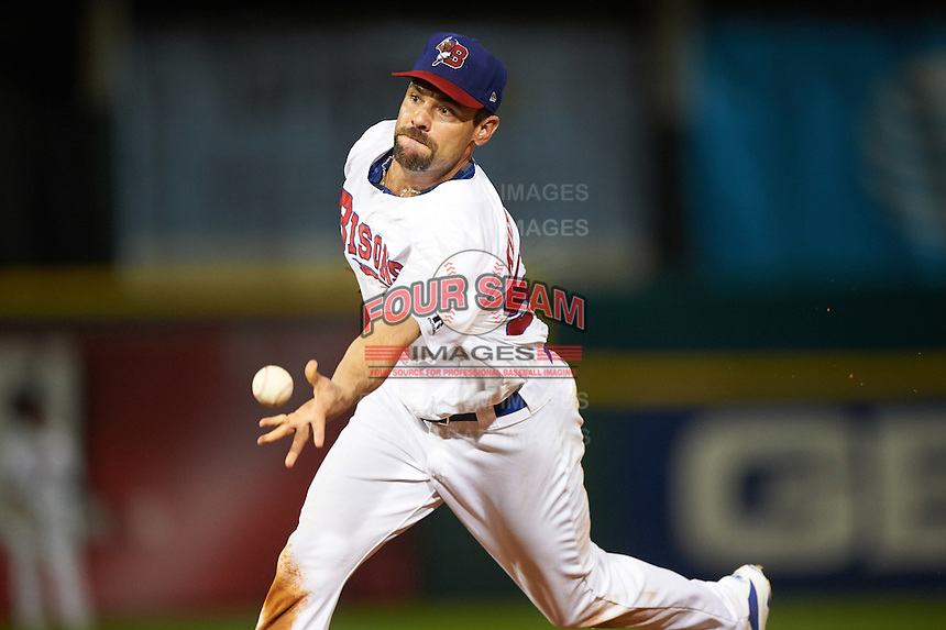 Buffalo Bisons first baseman Casey Kotchman (55) flips the ball to the pitcher covering first during a game against the Lehigh Valley IronPigs on August 29, 2016 at Coca-Cola Field in Buffalo, New York.  Buffalo defeated Lehigh Valley 3-2.  (Mike Janes/Four Seam Images)