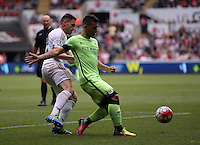 ( L-R ) Angel Rangel of Swansea City challenges Sergio Aguero of Manchester City during the Swansea City FC v Manchester City Premier League game at the Liberty Stadium, Swansea, Wales, UK, Sunday 15 May 2016