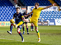 13th March 2021; Global Energy Stadium, Dingwall, Highland, Scotland; Scottish Premiership Football, Ross County versus Hibernian; Christian Doidge of Hibernian and Keith Watson of Ross County compete for possession of the ball