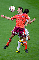 MELBOURNE, AUSTRALIA - NOVEMBER 14: Massimo Murdocca of the Roar controls the ball during the round 14 A-League match between the Melbourne Heart and Brisbane Roar at AAMI Park on November 14, 2010 in Melbourne, Australia (Photo by Sydney Low / Asterisk Images)