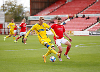 10th October 2020; The County Ground, Swindon, Wiltshire, England; English Football League One; Swindon Town versus AFC Wimbledon; Dion Donohue of Swindon Town marking Joe Pigott of AFC Wimbledon