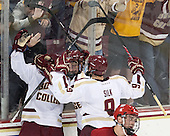 Michael Sit (BC - 18), Destry Straight (BC - 17), Brendan Silk (BC - 9) - The Boston College Eagles defeated the visiting University of Wisconsin Badgers 9-2 on Friday, October 18, 2013, at Kelley Rink in Conte Forum in Chestnut Hill, Massachusetts.