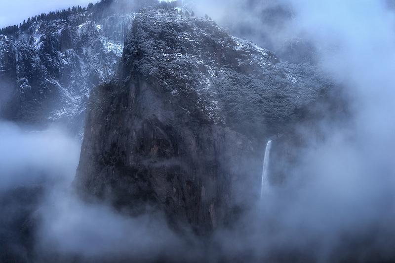Fog swirling around Bridalveil Falls. Yosemite National Park, CA
