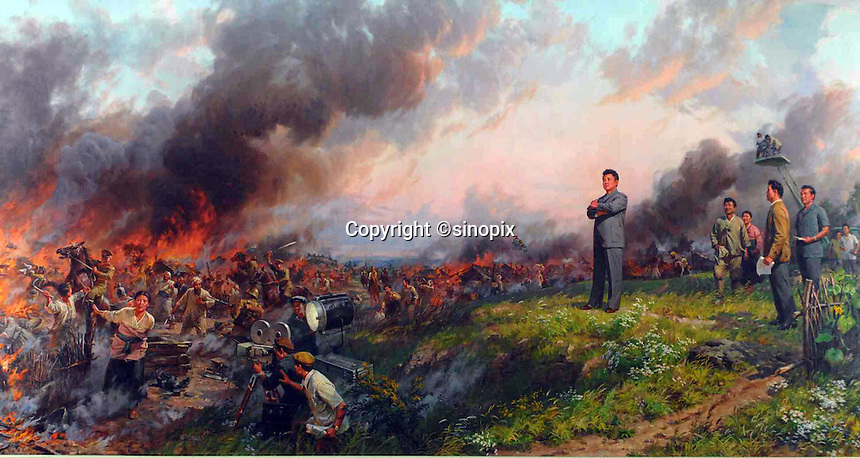 A war painting in the Pyongyang film studios and sets featuring Kim Jong-il as a film maker, overlooking a battle scene being flimed in North Korea.