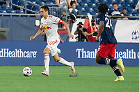 FOXBOROUGH, MA - MAY 22: Sean Davis #27 of New York Red Bulls advances the ball as DeJuan Jones #24 of New England Revolution comes int to tackle during a game between New York Red Bulls and New England Revolution at Gillette Stadium on May 22, 2021 in Foxborough, Massachusetts.