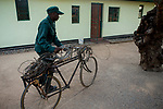 Anti-poaching scout with confiscated spears, bicycle, and snares, used by poachers, Kafue National Park, Zambia