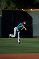 AZL Mariners right fielder Cesar Trejo (7) throws to home plate during an Arizona League game against the AZL D-backs on July 3, 2019 at Salt River Fields at Talking Stick in Scottsdale, Arizona. The AZL D-backs defeated the AZL Mariners 3-1. (Zachary Lucy/Four Seam Images)