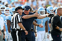CHAPEL HILL, NC - SEPTEMBER 28: Head coach Mack Brown of the University of North Carolina argues with Head Linesman Kavin McGrath during a game between Clemson University and University of North Carolina at Kenan Memorial Stadium on September 28, 2019 in Chapel Hill, North Carolina.