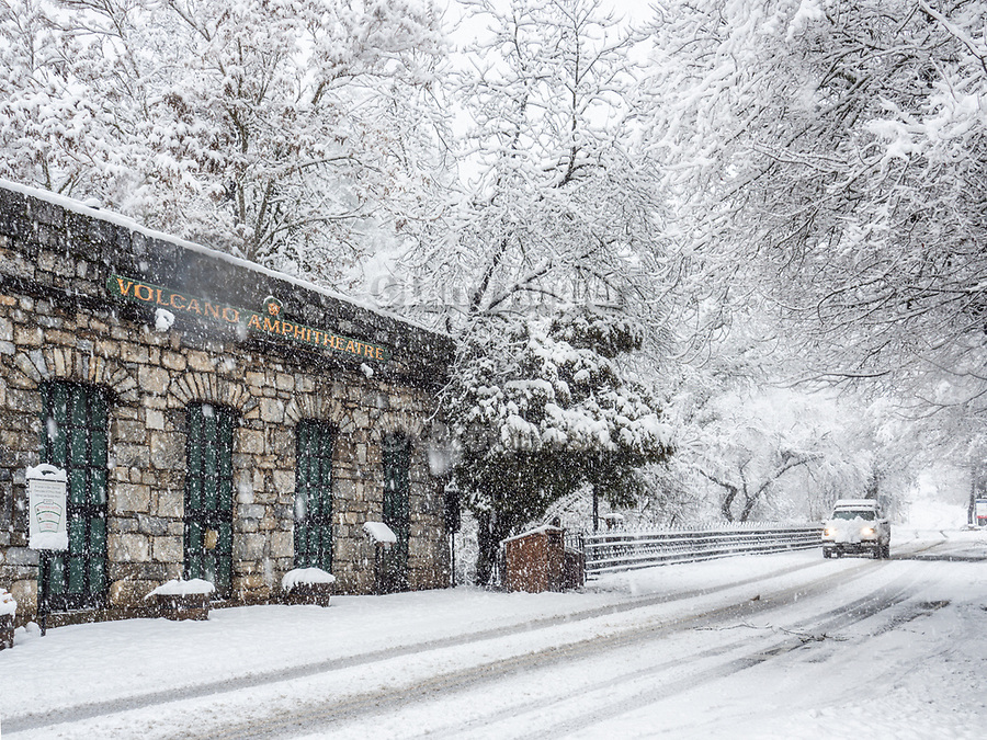 Stone façade of the Volcano Amphitheatre in the historic village of Volcano, during a rare winter snow, Amador County, Calif.